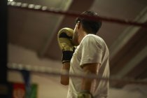Boxer practising in boxing ring — Stock Photo