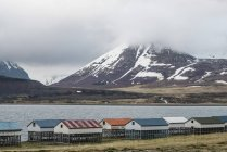 Cabins on stilts by waters edge, Westfjords, Iceland — Stock Photo