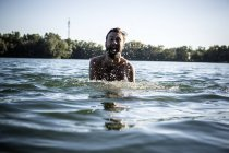 Man with open mouth, splashing in water, Berlin, Germany — Stock Photo