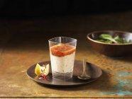 Salmon shot with orange and slice of lemon on plate — Stock Photo