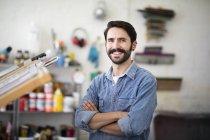 Portrait of young male printer in printing press studio — Stock Photo