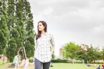 Young woman strolling in park — Stock Photo