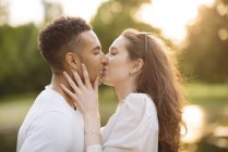 Side view of young couple kissing — Stock Photo