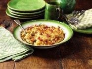 Swede and parsnip baked rice in vintage green bowl — Stock Photo
