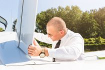 Pilot inspecting aircraft before flight — Stock Photo
