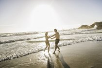 Mid adult couple playing in sea, Cape Town, South Africa — Stock Photo