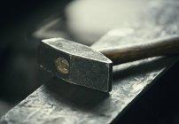 Hammer on iron anvil — Stock Photo