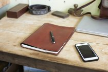 Leather bound book on table in leather workshop — Stock Photo