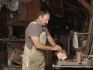 Boat builder in workshop — Stock Photo