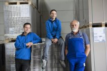 Portrait of team of factory workers — Stock Photo