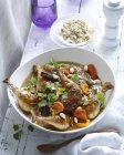Bowl of chicken tagine with apricots and almonds — Stock Photo