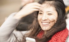 Portrait of mid adult woman, laughing — Stock Photo
