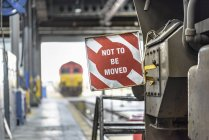 View of warning sign on locomotive with defocussed background — Stock Photo
