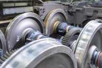 Locomotive wheel sets in train works, close up — Stock Photo
