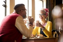 Quirky couple relaxing in bar and restaurant, Bournemouth, England — Stock Photo