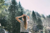 Rear view of young woman looking at forest — Stock Photo