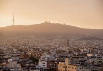 Elevated hazy cityscape with distant view of montjuic, Barcelona, Spain — Stock Photo