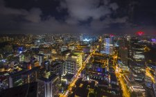 High angle cityscape and city lights at night, Singapore, South East Asia — Stock Photo