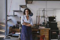 Portrait of smiling female jeweler in workshop — Stock Photo