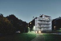 Apartment block at dusk, Chambery, Rhone-Alpes, France — Stock Photo