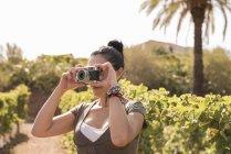Mature female winemaker tacking photo in vineyard, Las Palmas, Gran Canaria, Spain — Stock Photo