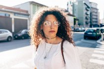 Young woman in street in sunshine, Milan, Italy — Stock Photo