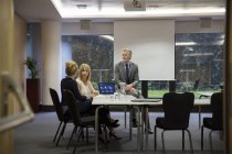 Colleagues having meeting in conference room — Stock Photo