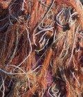 Vista superior de las redes de pesca con cortina marrón - foto de stock