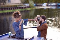 Couple taking photo on canal boat — Stock Photo