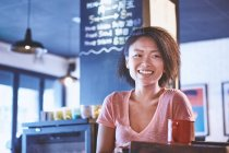 Happy woman in cafe, Shanghai French Concession, Shanghai, China — Stock Photo