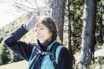 Hiker shielding eyes looking away smiling, Madonna di Pietralba, Trentino-Alto Adige, Italy, Europe — Stock Photo
