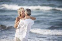 Couple hugging on beach, Palma de Mallorca, Spain — Stock Photo