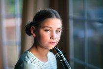Portrait of girl with clarinet looking at camera — Stock Photo