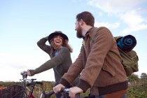 Couple enjoying cycling on marshes — Stock Photo