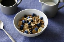 Close up of breakfast with cereal and berries — Stock Photo