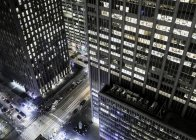 Elevated view of street at night, skyscraper in foreground, New York City, New York, USA — Stock Photo