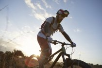 Male mountain biker riding on moorland — Stock Photo