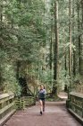 Woman running in forest, Vancouver, Canada — Stock Photo