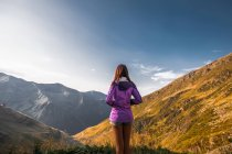 Rear view of young woman looking on mountain landscape, Draja, Vaslui, Romania — Stock Photo