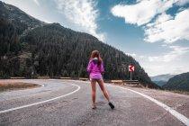 Young woman standing on mountain road, Draja, Vaslui, Romania — Stock Photo