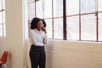 Woman making telephone call in office — Stock Photo