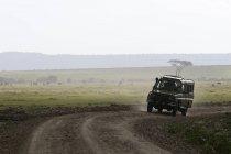 Jeep during safari, Masai Mara National Reserve, Kenya — Stock Photo