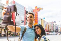 Young tourist couple taking camera selfie on street, Bangkok, Thailand — Stock Photo
