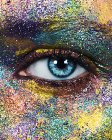 Blue eyed woman with glittery colored powder on face — Stock Photo
