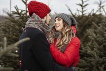 Romantic young couple shopping for christmas tree from forest — Stock Photo