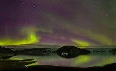 Aurora Borealis at Qualerallit glacier, South Greenland — Stock Photo