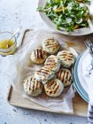 Still life of sage and pine nut patties with summer salad, overhead view — Stock Photo