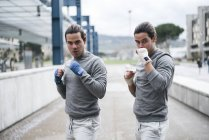 Twin boxers in fighting stance outdoor — Stock Photo