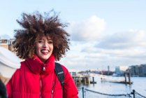 Portrait of smiling young girl against London city at background, England, UK — Stock Photo