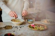 Woman preparing vegan dish — Stock Photo